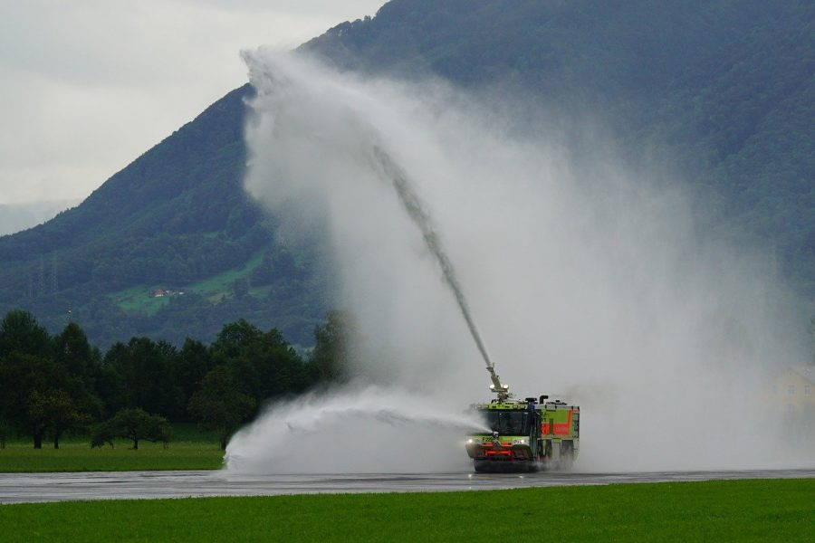 Airport fire truck in training, discharging water
