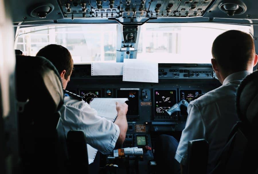 Pilots performing their pre-flight checklist