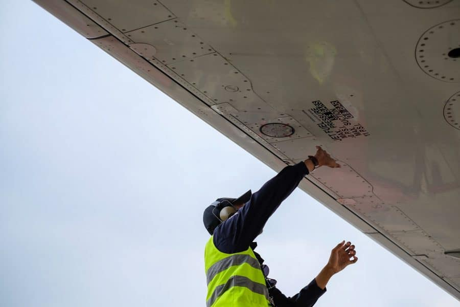 Engineer performing fuel inspection