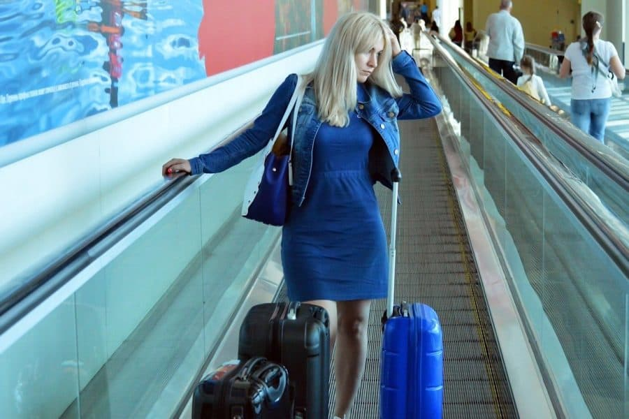 Tired traveler using a moving walkway