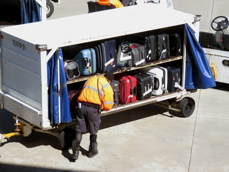Ground crew checking baggage before loading into airplane